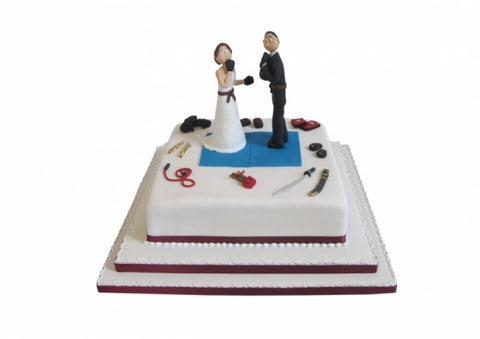 """The Gloves are Off' Wedding Cake"