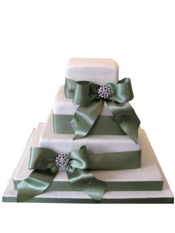 Three tiers diamante and ribbon wedding cake