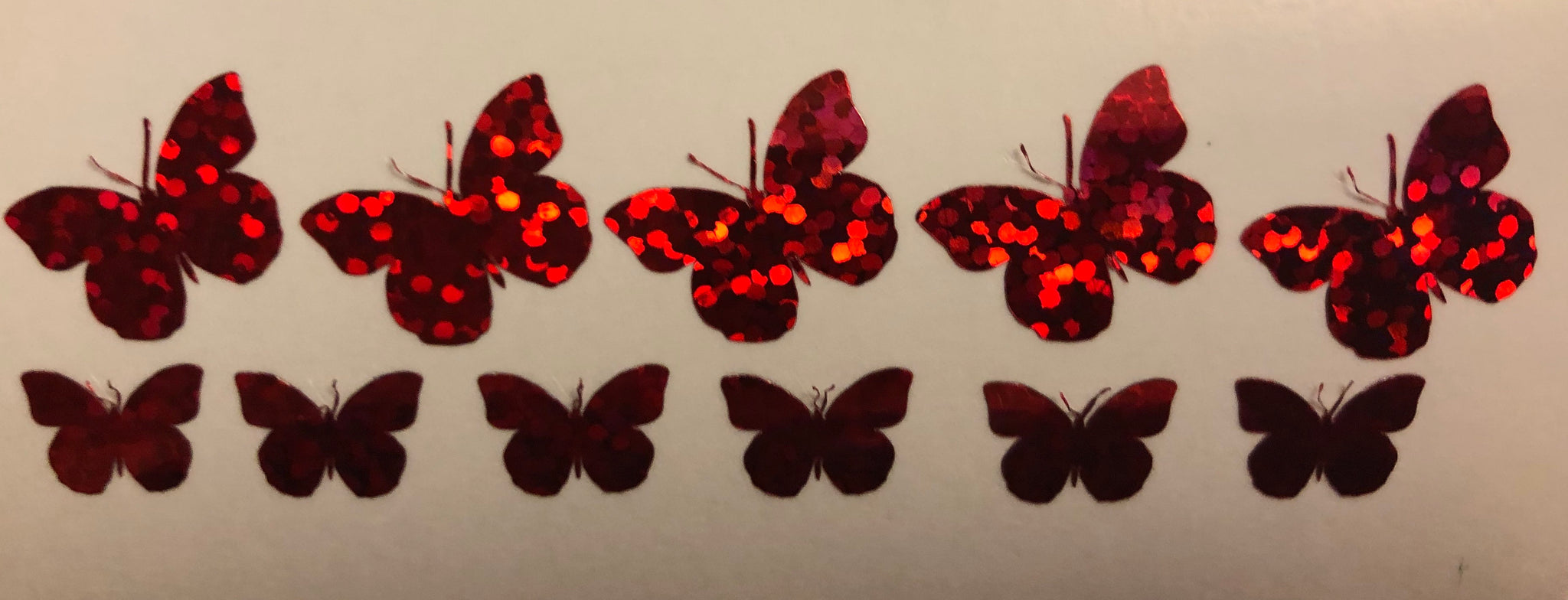 Red holographic butterflies
