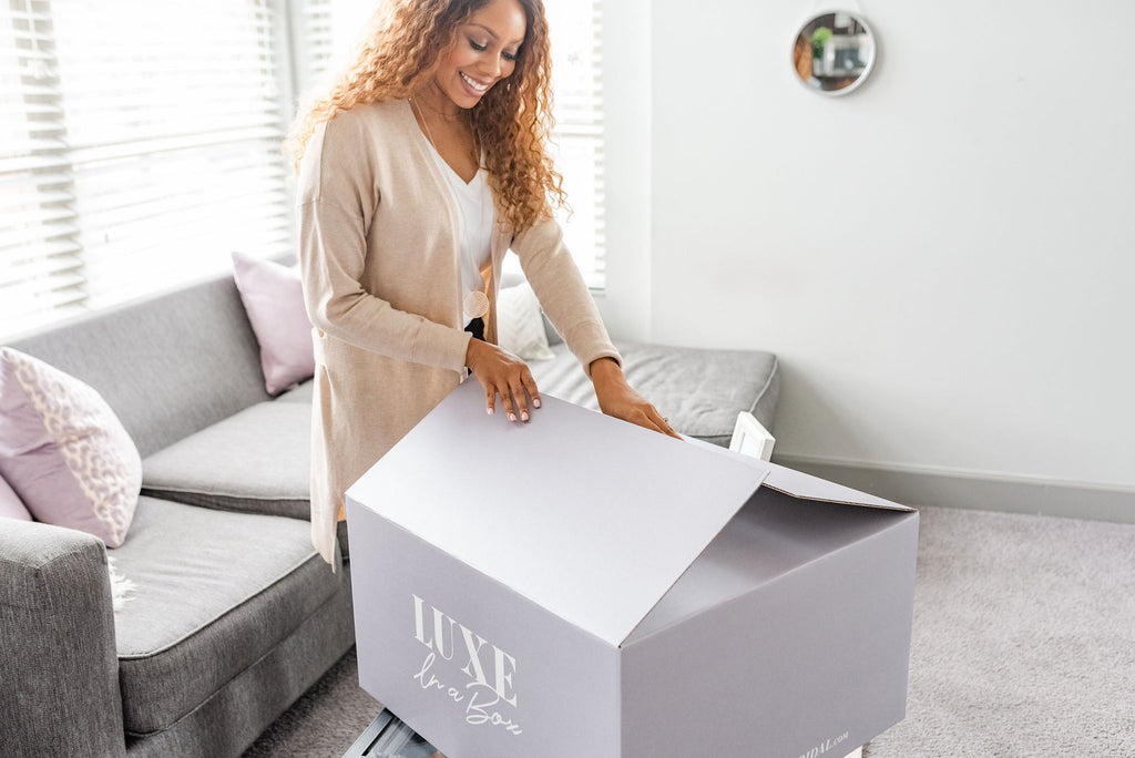Bride opening box for at home bridal try on