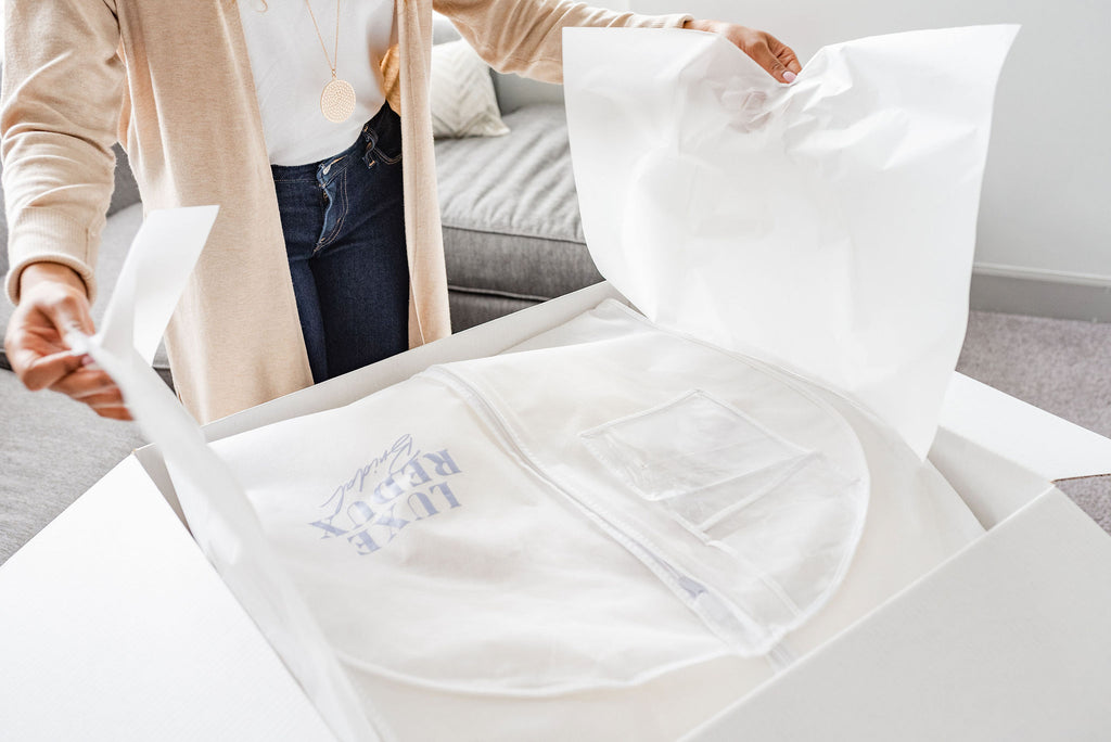 Woman opening online wedding dresses at home.