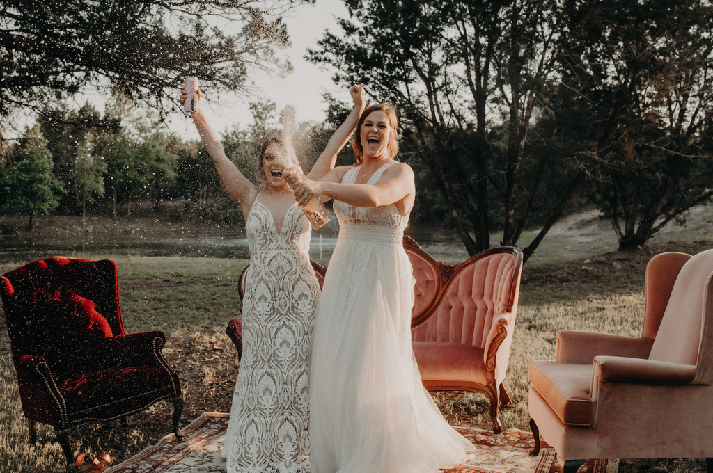 Brides celebrating with champagne.