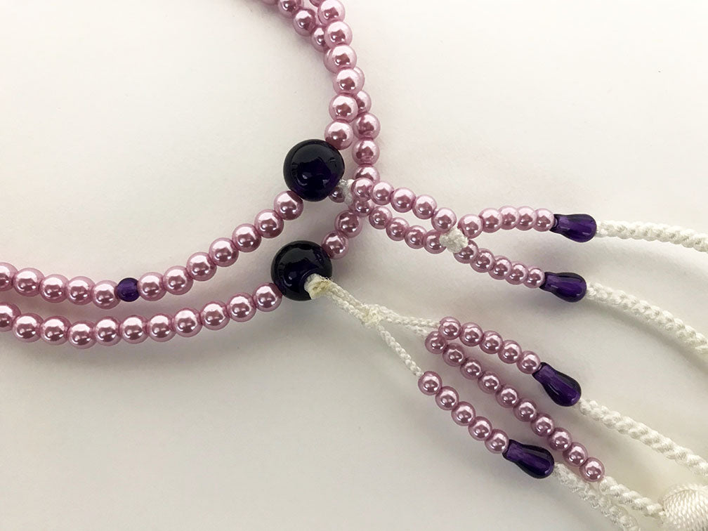 Purple Beads with White Knitted Tassels