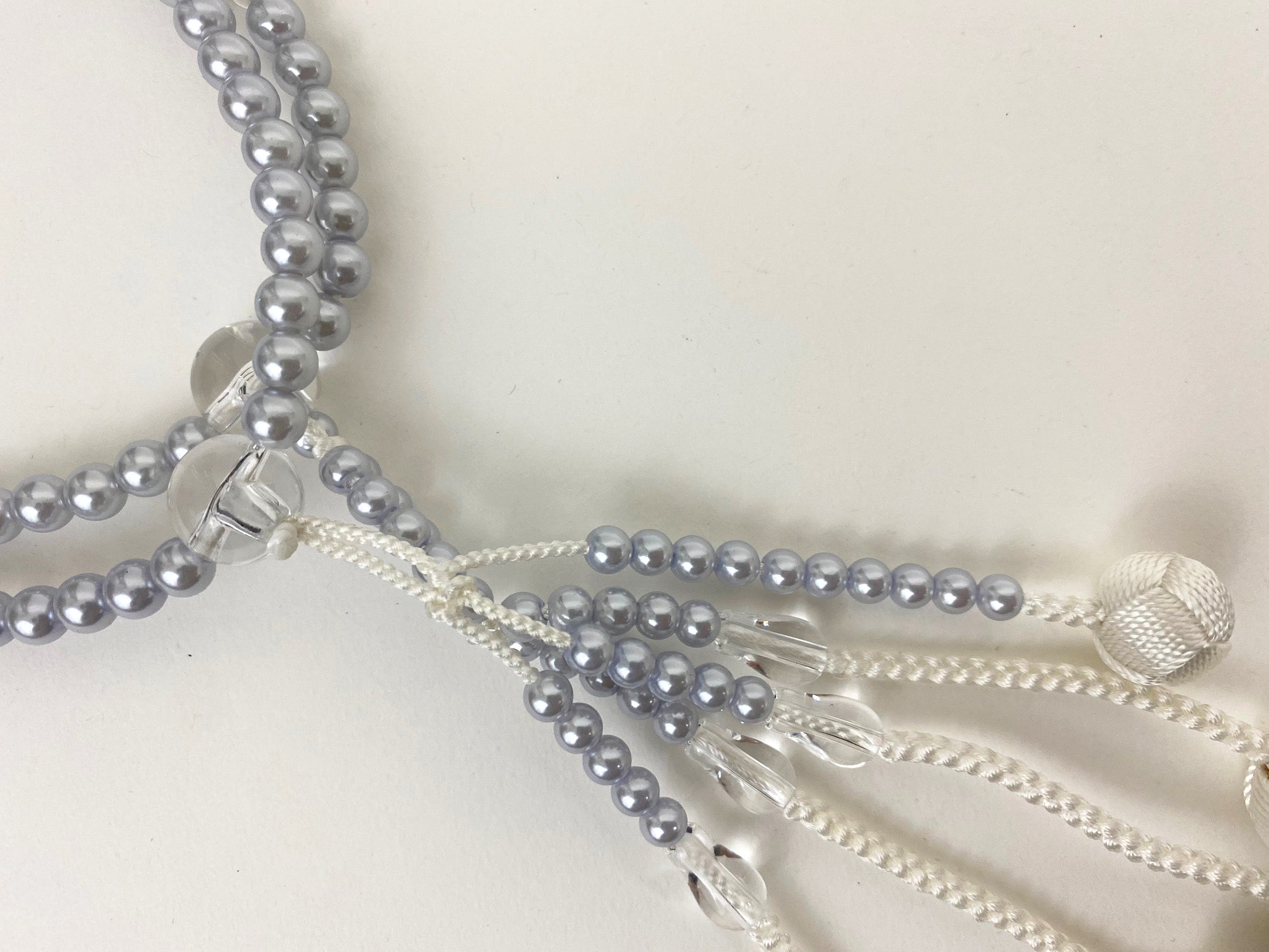 Bluish Grey Pearl Beads with Knitted Tassels