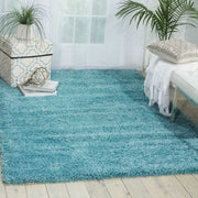 Amore Collection Shag Area Rug in Turquoise by Nourison