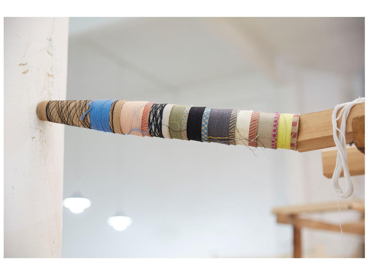This image shows a stack of different colored yarn spoons in the Marrakshi Life atelier.