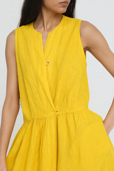 Black Crane Classy Tank Dress in Mustard on model view front detail