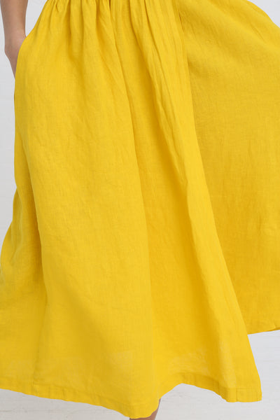 Black Crane Classy Tank Dress in Mustard on model view front skirt detail