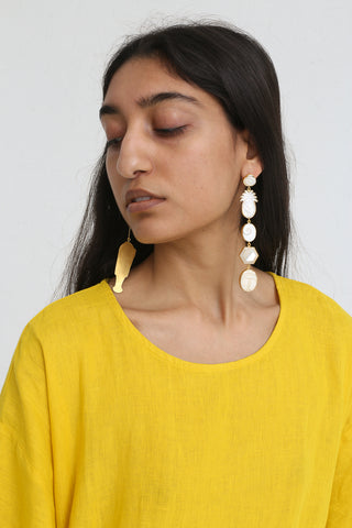 Grainne Morton Large Pearl Mismatched Drop Earrings in Gold Plated on model view