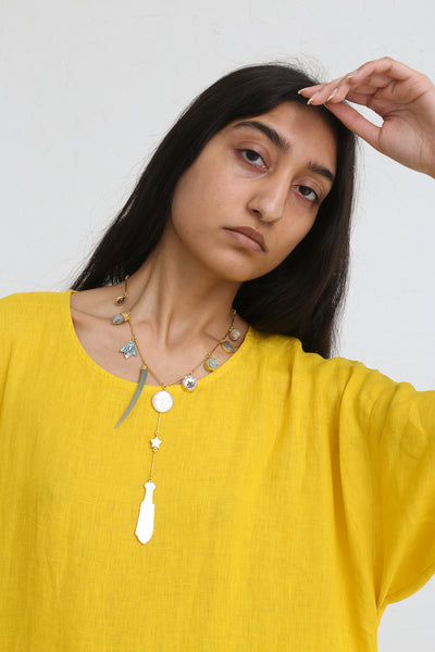 Grainne Morton Man on the Moon Necklace on model view