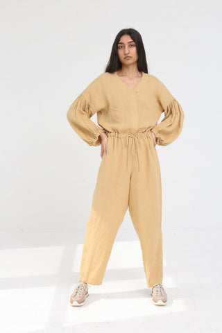 Black Crane Balloon Sleeve Jumpsuit in Tan on model view front