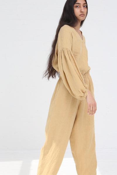 Black Crane Balloon Sleeve Jumpsuit in Tan on model view side