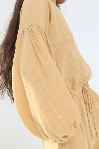 Black Crane Balloon Sleeve Jumpsuit in Tan on model view sleeve detail