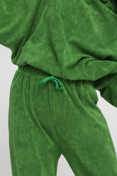 Baserange Douglas Pants Rib Terry Fleece in Grass Green on model view front waist detail