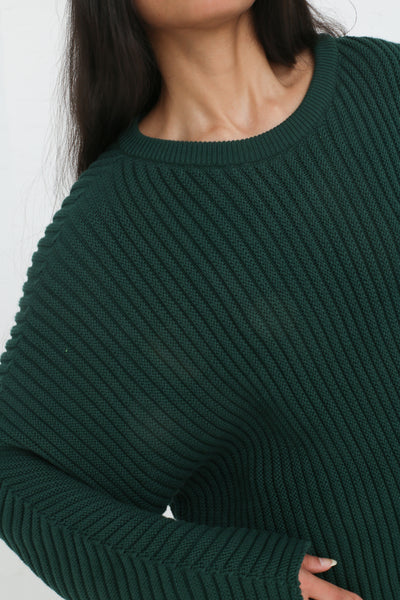 Baserange Kai Sweater Cotton Rib in Dark Green on model view neck detail