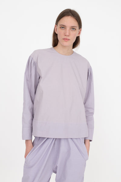 Cosmic Wonder Organic Cotton Meditation Pullover Shirt in Violet Flame, Front View Hands in Pocket