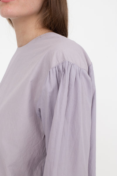 Cosmic Wonder Organic Cotton Meditation Pullover Shirt in Violet Flame, Side View Close Up of Shoulder