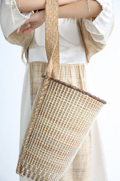 Incausa Mantiteka Basket By Kayapo People in Natural with Wild Cotton detail view