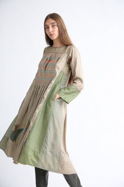 Injiri Silk Dress in Green on model view side