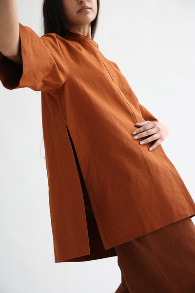 Studio Nicholson Suma Shirt - Coated Linen in Truffle side seam slit detail