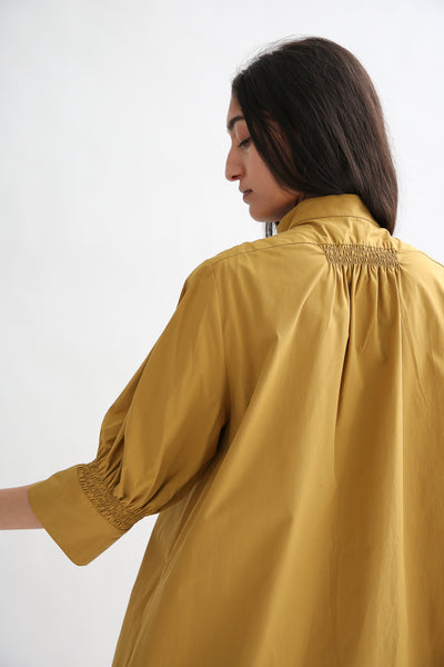 Studio Nicholson Knoll Dress - Powder Cotton in Tobacco yoke and cuff shirring detail back view