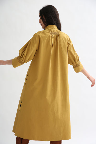 Studio Nicholson Knoll Dress - Powder Cotton in Tobacco onm odel view back