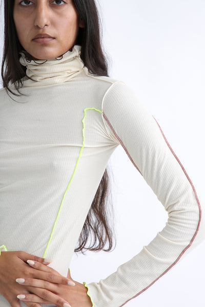 Baserange Omato Turtleneck in Off White Contrast sleeve view