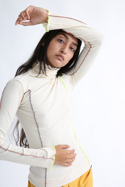 Baserange Omato Turtleneck in Off White Contrast on model view front
