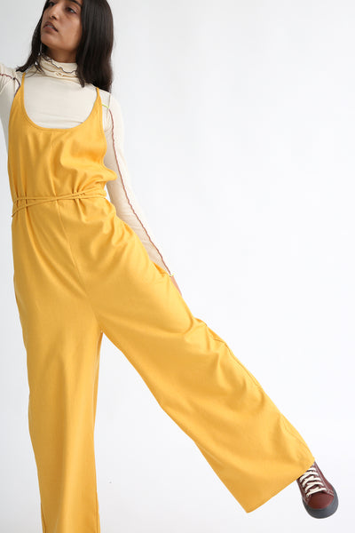 Baserange Otay Jumpsuit in Gold front leg view