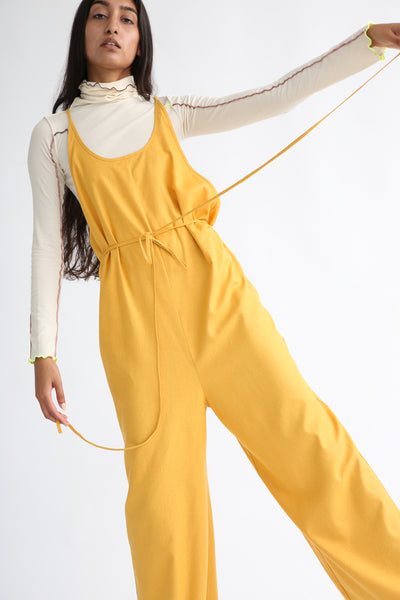Baserange Otay Jumpsuit in Gold on model view front