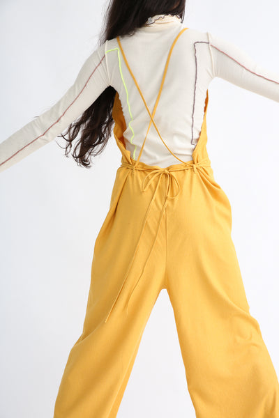 Baserange Otay Jumpsuit in Gold on model view back