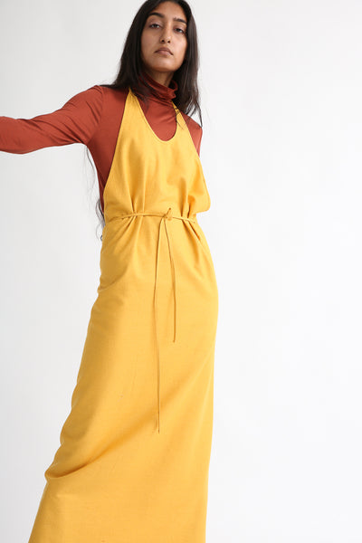 Baserange Apron Dress in Gold on model view front