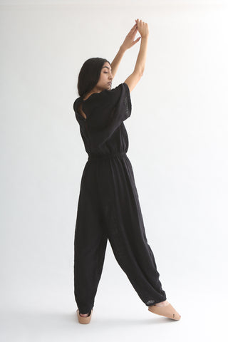 Black Crane Easy Jumpsuit in Black full length on model back
