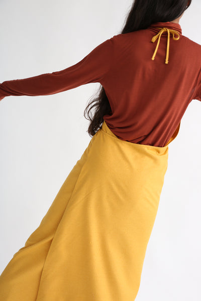 Baserange Apron Dress in Gold on model view back