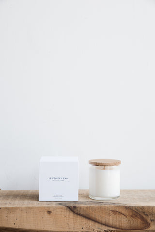 Le Feu De L'eau Candle in Ivory, Patchouli + Amber | Oroboro Store | Brooklyn, New York