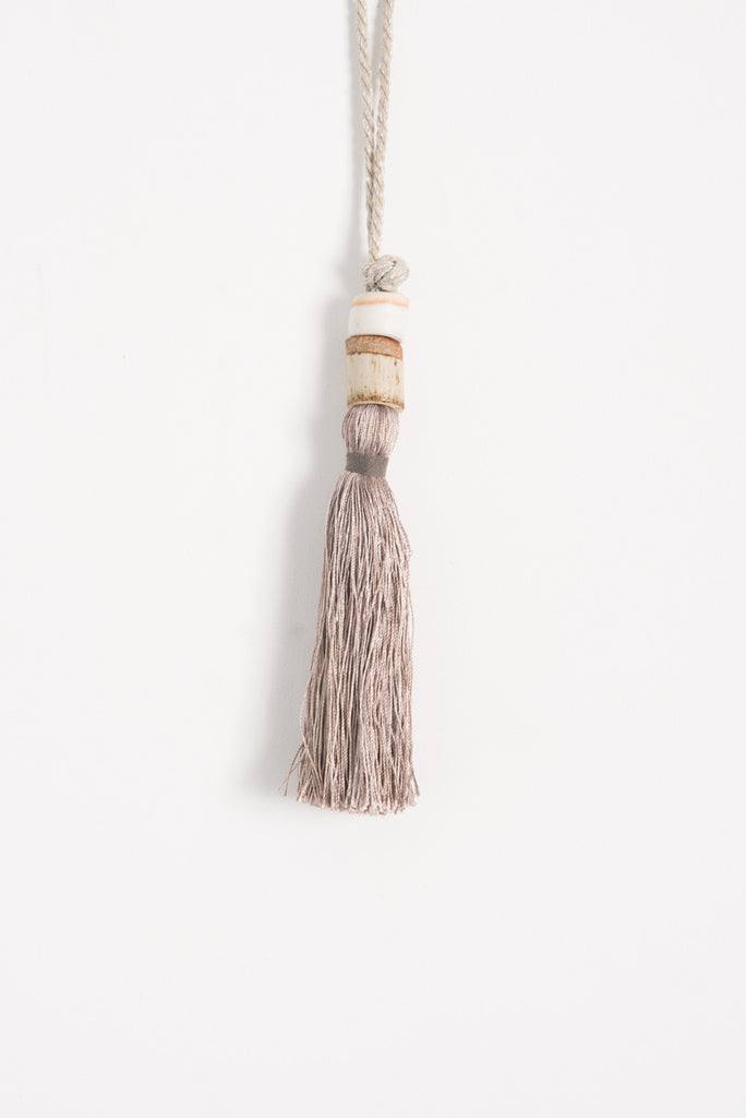 All Roads Tassel with Two Ceramic Beads and Metallic Rope in Silver | Oroboro Store | Brooklyn, New York