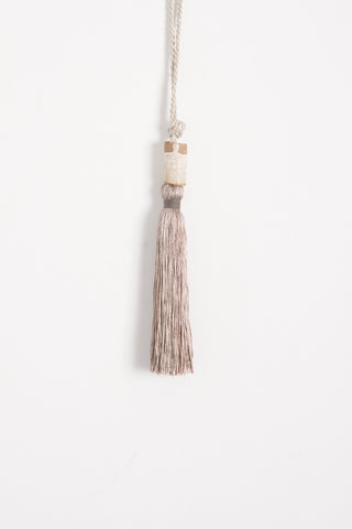 All Roads Tassel with Ceramic Bead and Metallic Rope in Silver | Oroboro Store | Brooklyn, New York