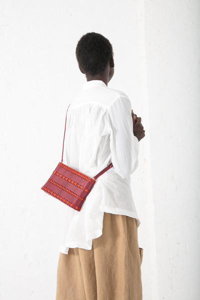 Hatori Clutch with Magnet Closure in Amaranto Leather / Orange Lacing | Oroboro Store | New York, NY