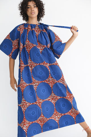 Odile Jacobs Long Wax Cotton Neck Tie Dress with Short Sleeves in Blue Circle on model view front