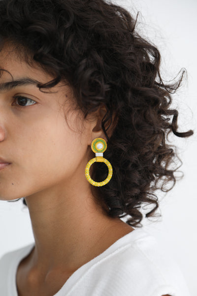 Robin Mollicone Small Beaded Hoop Earrings in Yellow / White Howlite on model view