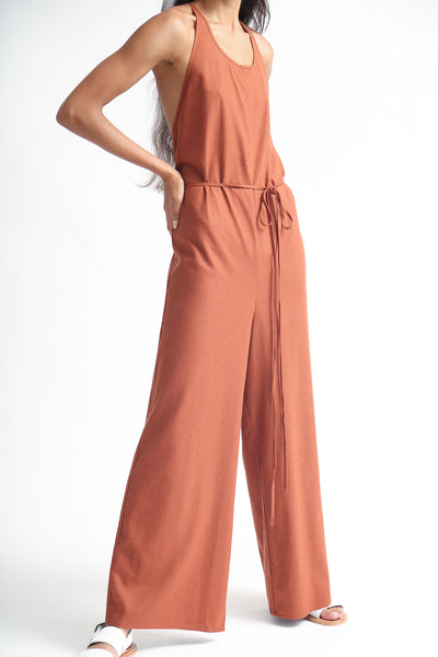 Baserange Otay Jumpsuit - Raw Silk in Rust on model view side