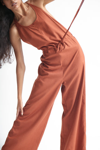 Baserange Otay Jumpsuit - Raw Silk in Rust on model view front