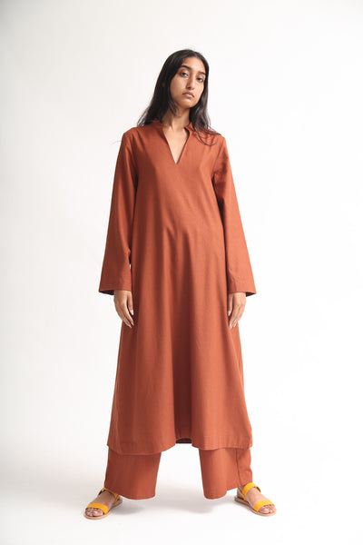 Baserange Ita Dress - Raw Silk in Rust on model view front
