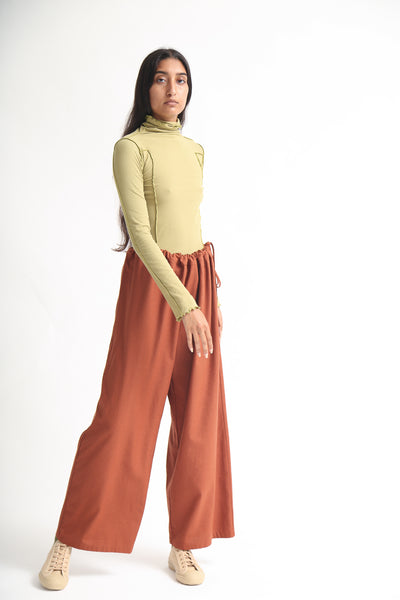Baserange Ita Pant - Raw Silk in Rust on model view front