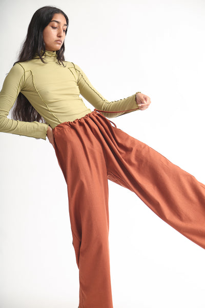 Baserange Ita Pant - Raw Silk in Rust on model view side