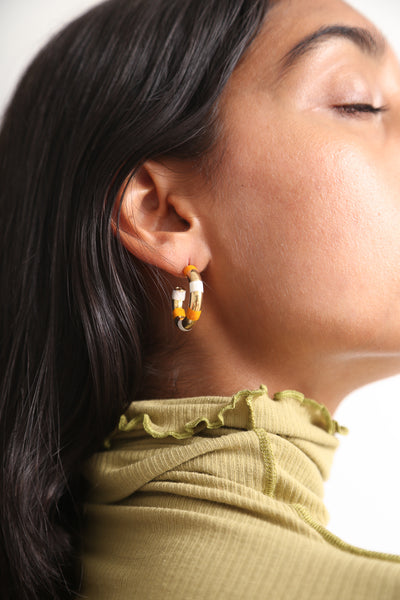 Abby Carnevale Striped Hoops in Orange / White on model view