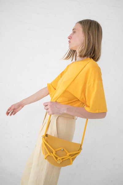 Eatable of Many Orders Monkey Bebe Bag in Yellow with Yellow Rope | Oroboro Store | New York, NY