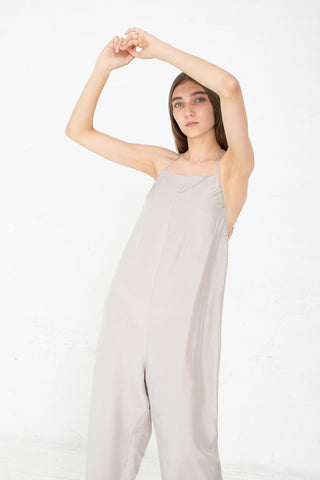 Baserange Otay Honday Jumpsuit in Voile Silk Tomita Grey Front View Arms Above Head, Oroboro Store, New York, NY