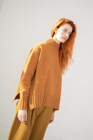 Studio Nicholson High Neck Knit with Side Slit in Gazelle Lambs Wool | Oroboro Store | New York, NY
