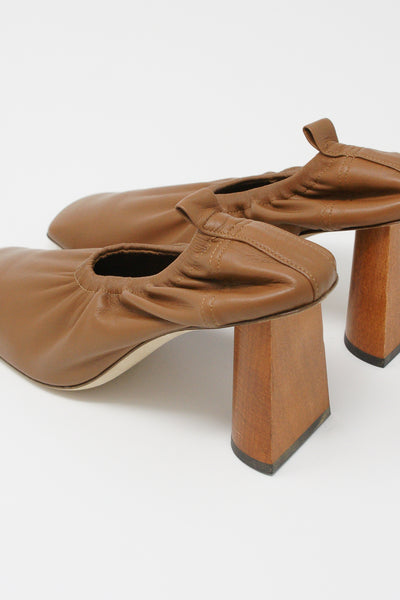 Rejina Pyo Edie Pump in Brown diagonal back view